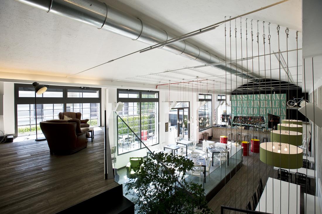 Arredamento in stile industriale un pub ristorante svela for Arredamento urban