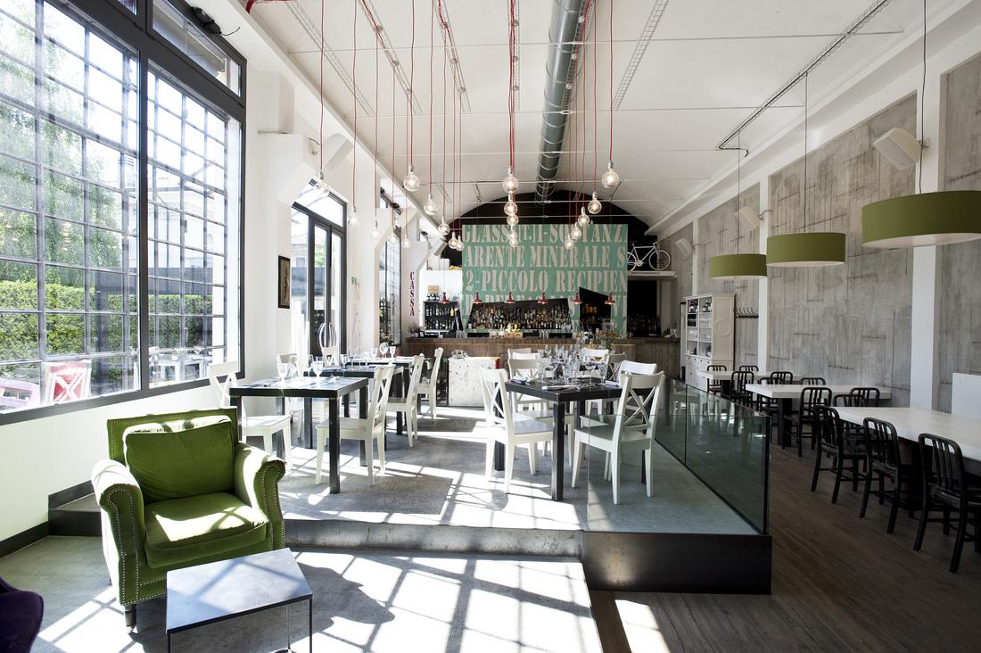 Arredamento in stile industriale un pub ristorante svela for Cargo arredamento milano